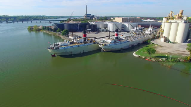 Two Industrial Freighter Ships in Dock, aerial view video