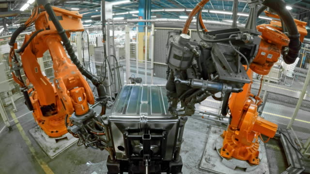 LD Two industrial robots welding a product video