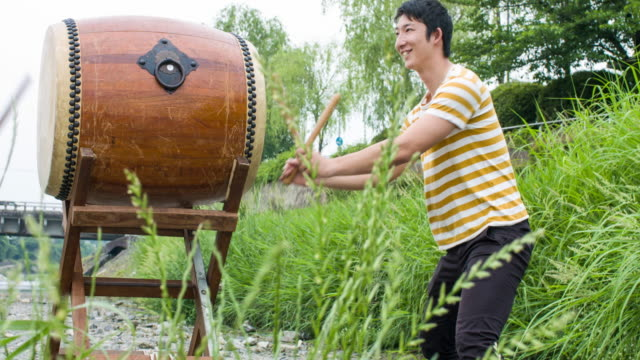 Two Japanese men playing Taiko drum together video