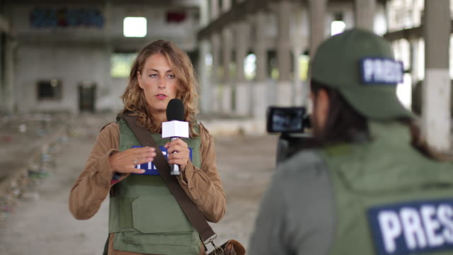 Two journalist reporting live Two journalists without borders reporting from the war zone journalist stock videos & royalty-free footage