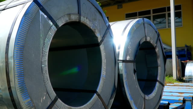 two large rolls of tin-plate are in the warehouse of the plant - alluminio video stock e b–roll