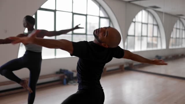 Two male ballet dancers spinning together in studio Two african-american male ballet dancers spinning together in studio ballet stock videos & royalty-free footage