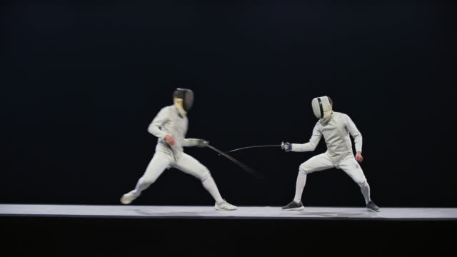 ld two male fencers in a blade action during a bout - conflittualità video stock e b–roll