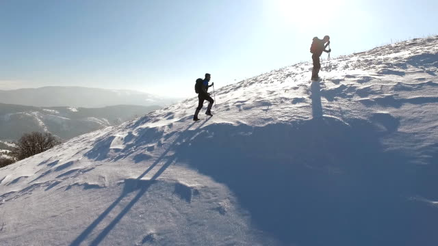 two man climbing on mountain covered with snow - альпинизм стоковые видео и кадры b-roll