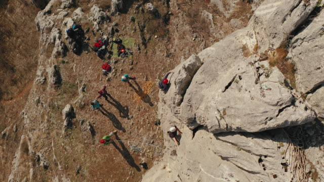 Two man climbs a rock with rope. Sport climbing, lead.