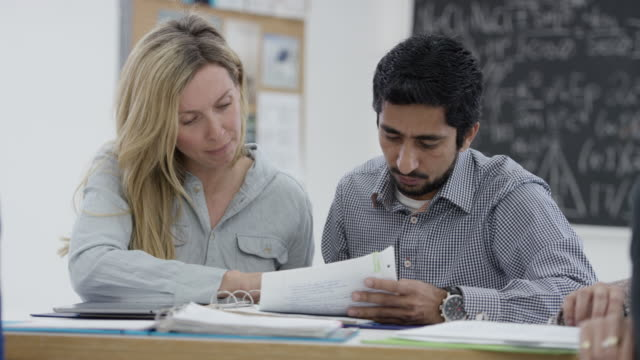 Two Mature Students Study Together