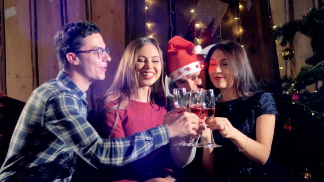 Two men and women enjoying some Christmas wine. video