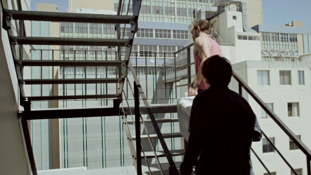 Two men arriving on rooftop party video