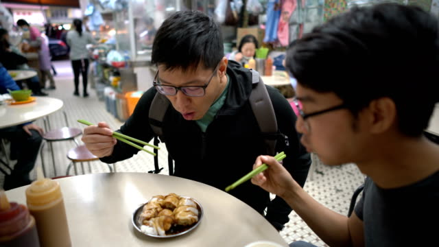 4K Two Men Eating Rice Sheet Rolls with deep fried Chinese Bread video