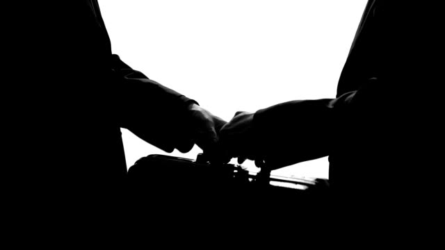 stockvideo's en b-roll-footage met twee mannen handshaking na het overbrengen van de koffer, zakelijke overeenkomst, omkopen - uitwisselen