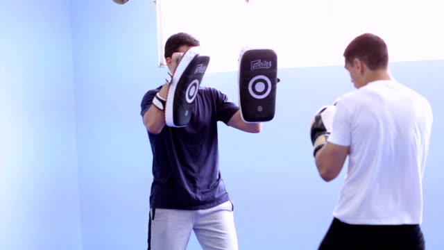 Two men having boxing workout video