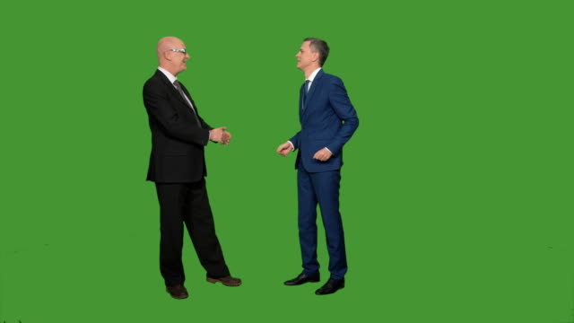 Two men in suits greeting and talking video