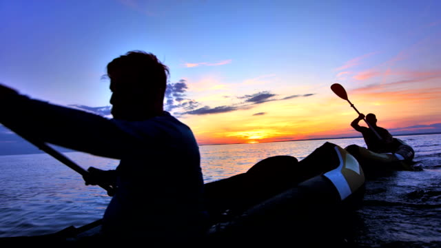 SLO MO Two Men Kayaking At Sunset video