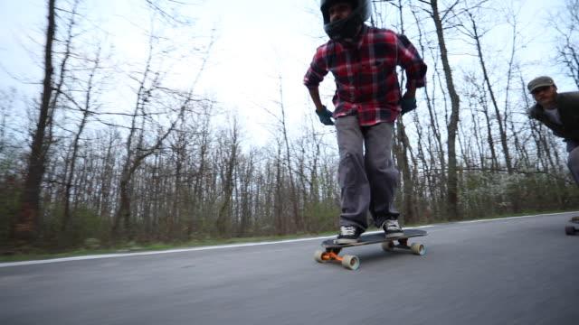 Two men riding Skateboards