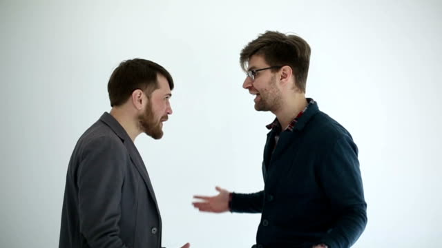 Two men swears at white background. Slow motion.