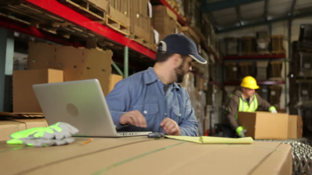 Two men working in shipping industry video