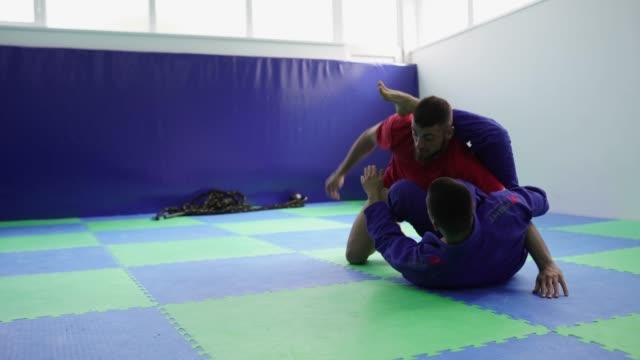 Two men wrestling training in gym