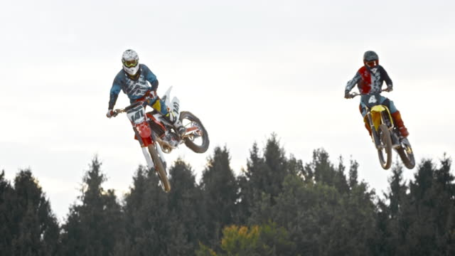 SLO MO Two motocross riders doing a jump