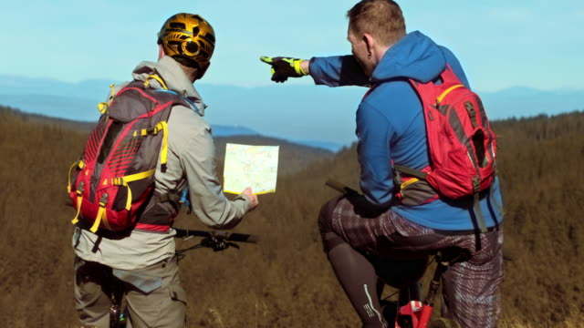 LD Two mountain bikers checking the map video