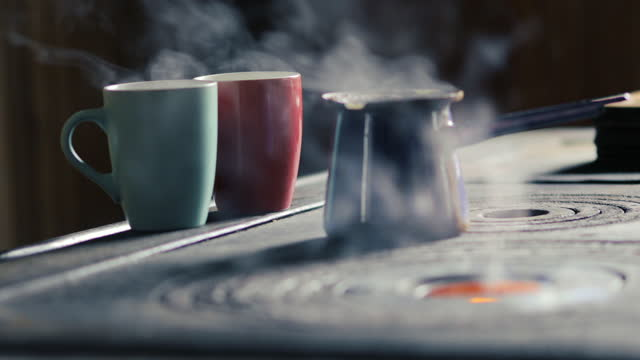 Two Mugs and Coffeepot on Wood Burning Stove