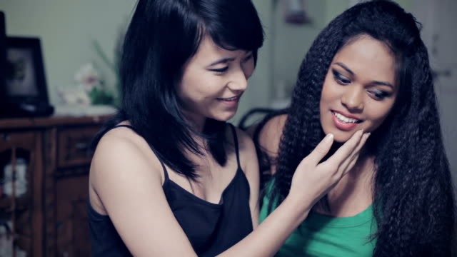 Two multi ethnic Asian young women in love. video