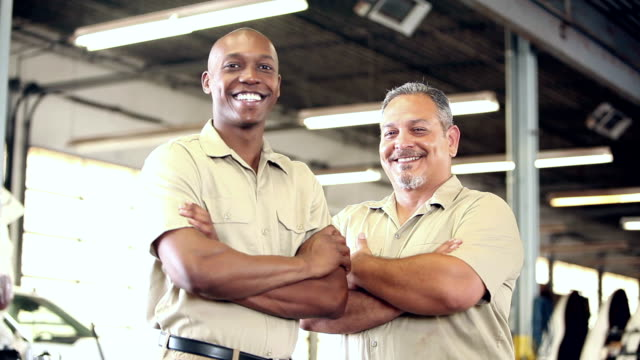 Two multi-ethnic workers in trucking industry video