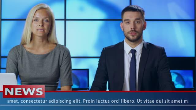 two news presenter in broadcasting studio - debate стоковые видео и кадры b-roll