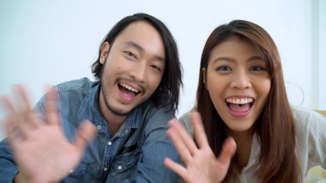 Two of young Asian blogger or vlogger using video online live streaming and broadcasting