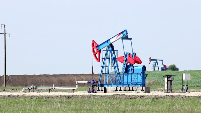 two oil pump jack on field video