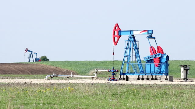 two oil pump jack on oilfield video