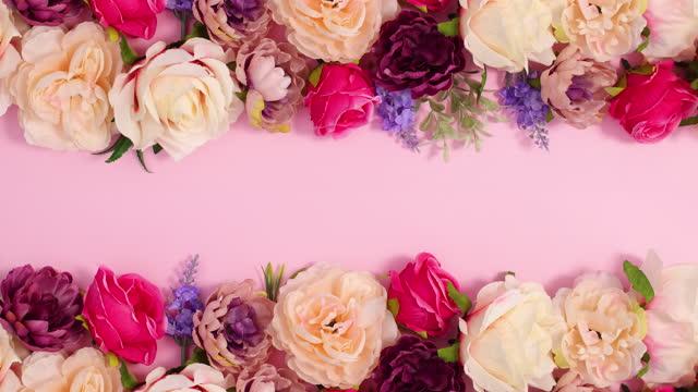 due pennelli di vernice che passano e lasciano fiorire alle spalle. stop motion - bouquet video stock e b–roll