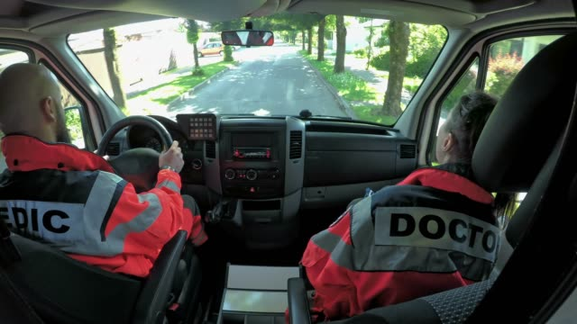 LD Two paramedics driving in an ambulance video