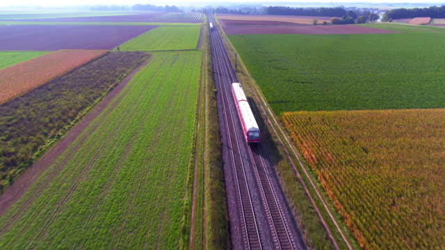 two passenger trains meeting in the countryside - train stock videos and b-roll footage