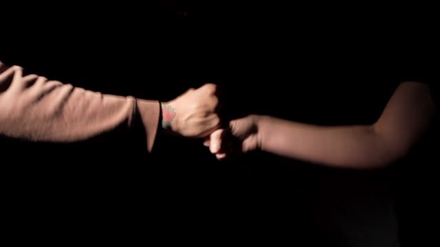 two people engage in urban hand greeting video
