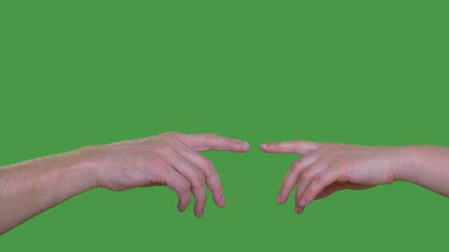 stockvideo's en b-roll-footage met twee mensen handen aan te raken met de wijsvinger geïsoleerd op groene achtergrond alfakanaal, ingetoetst groen scherm - hand pointing