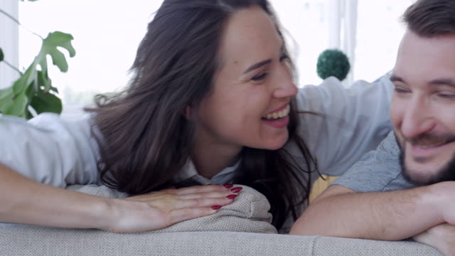Two people hugging on the sofa video