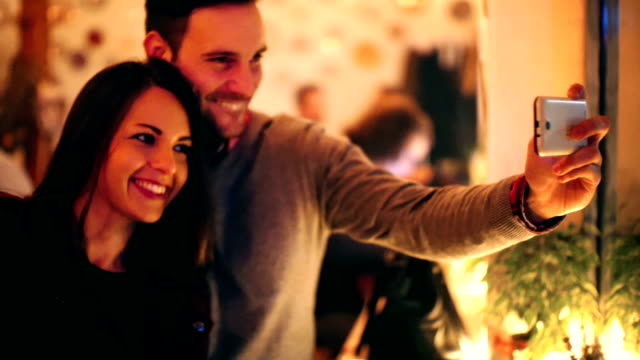 two people taking selfies at coffee shop. - date night stock videos & royalty-free footage