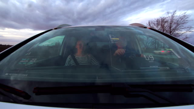 Two people traveling in smart car video