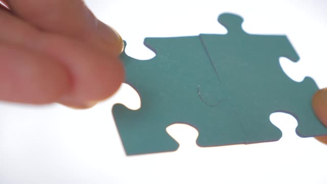two pieces of puzzle are interconnected. problem solution concept. relationships concept. successful negotiations. communication concept social psychology of close relationships. problem solving skill - due oggetti video stock e b–roll