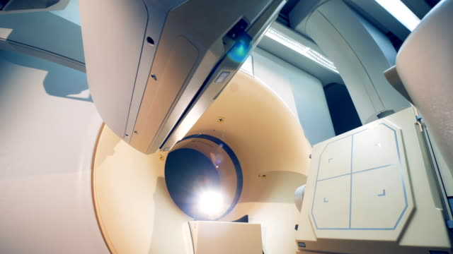 Two platforms of an imaging unit are rotating and fixating in one place Two platforms of an imaging unit are rotating and fixating in one place. 4K oncology stock videos & royalty-free footage