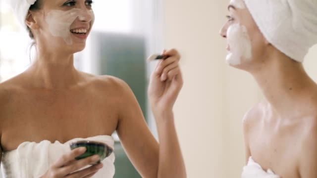 two pretty women applying a facial mask - facial stock videos & royalty-free footage