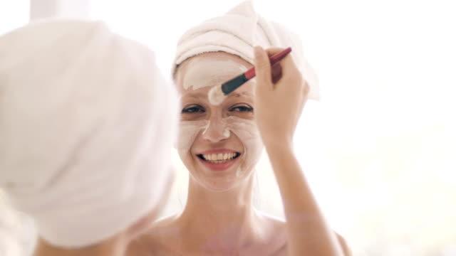 two pretty women applying a facial mask - spa facial stock videos & royalty-free footage