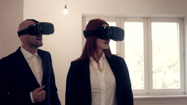 Two Real Estate agents using VR headset