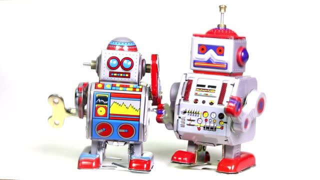 Two retro tin toy robots video