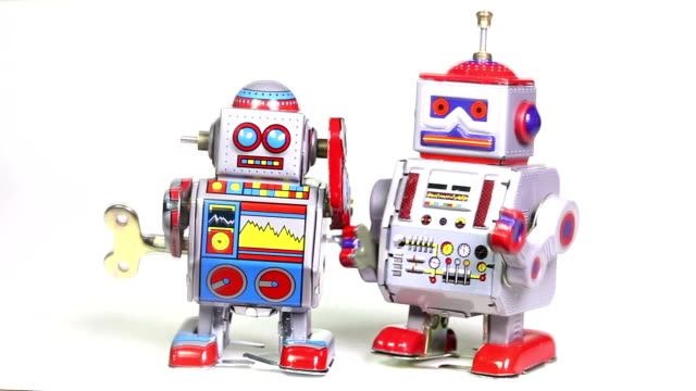 stockvideo's en b-roll-footage met two retro tin toy robots - speelgoed