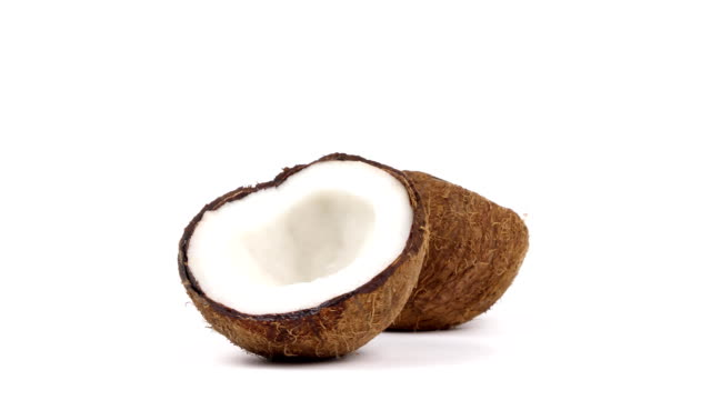 Two ripe coconut halves with yummy pulp rotating on white isolated background. Loopable seamless Two ripe tropical coconut halves with yummy white pulp rotating on white isolated background. Healthy fresh tropical fruits. Loopable seamless cocos rotating coconut stock videos & royalty-free footage