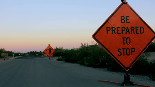 Two Road Hazard Signs Warn Motorists of Construction Ahead video