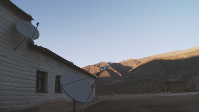 Two Satellite Dishes in a Mountain Public School of Argentina.