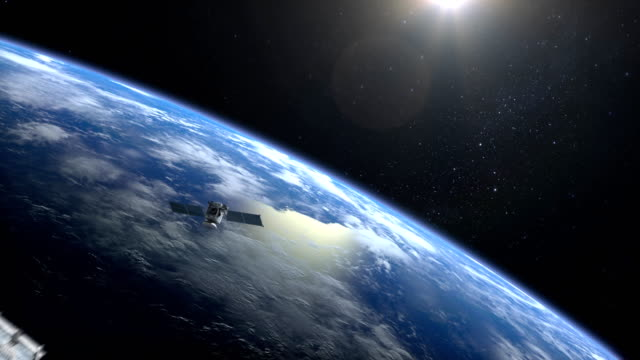 Two satellites scan and monitor the Earth. Satellites appear in the frame and slowly fly away. The Earth's horizon is turned to the right. 4K. video
