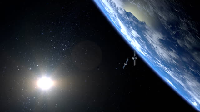 two satellites scan and monitor the earth. the satellites is flying from far away, and disappears from the camera. 4k. - geografia fisica video stock e b–roll